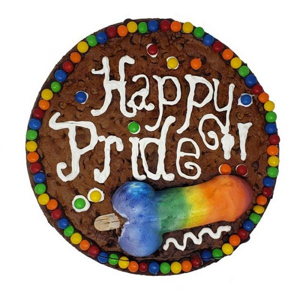 Cookie cake with Happy Pride message and a rainbow penis cookie topper